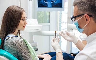 Боли после имплантации зубов - Линия Улыбки